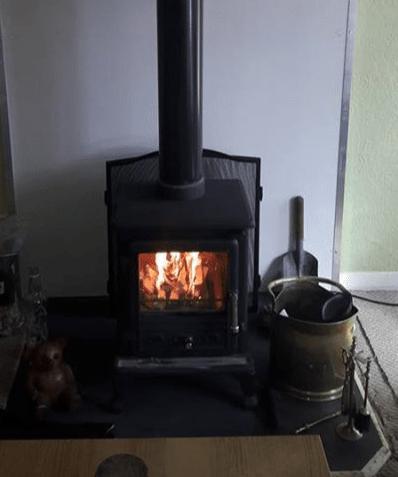 Shack log stove